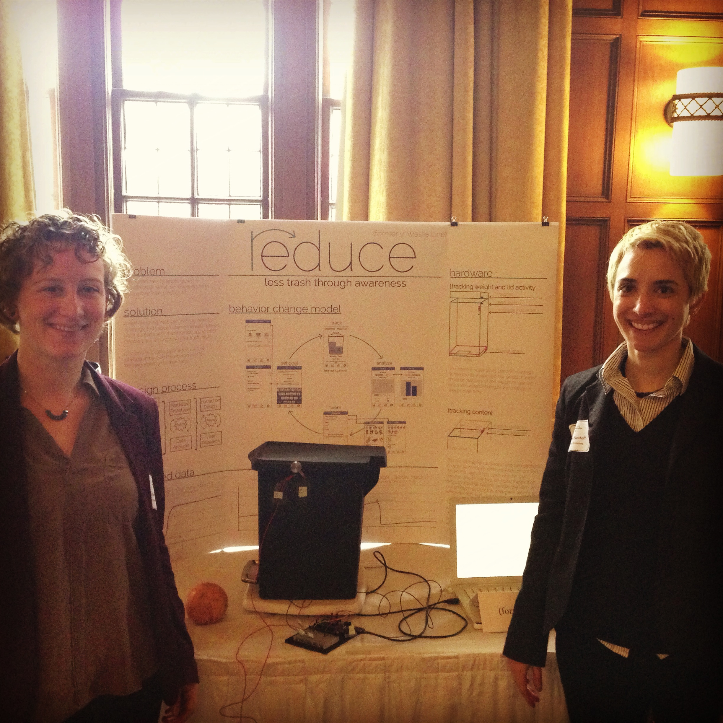 One of my teammates and I presenting our poster with hardware prototype