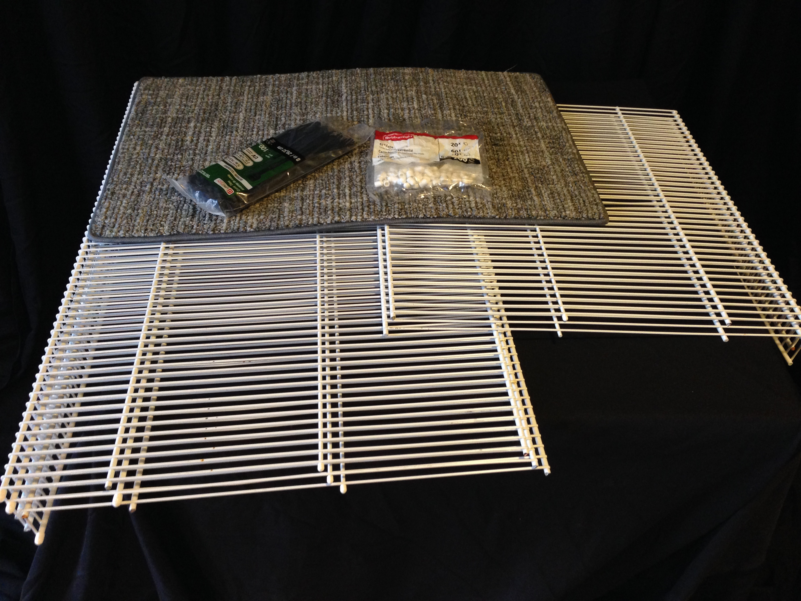 Catio materials: Wire shelving, outdoor zip ties,plastic end caps, and a sample carpet square.