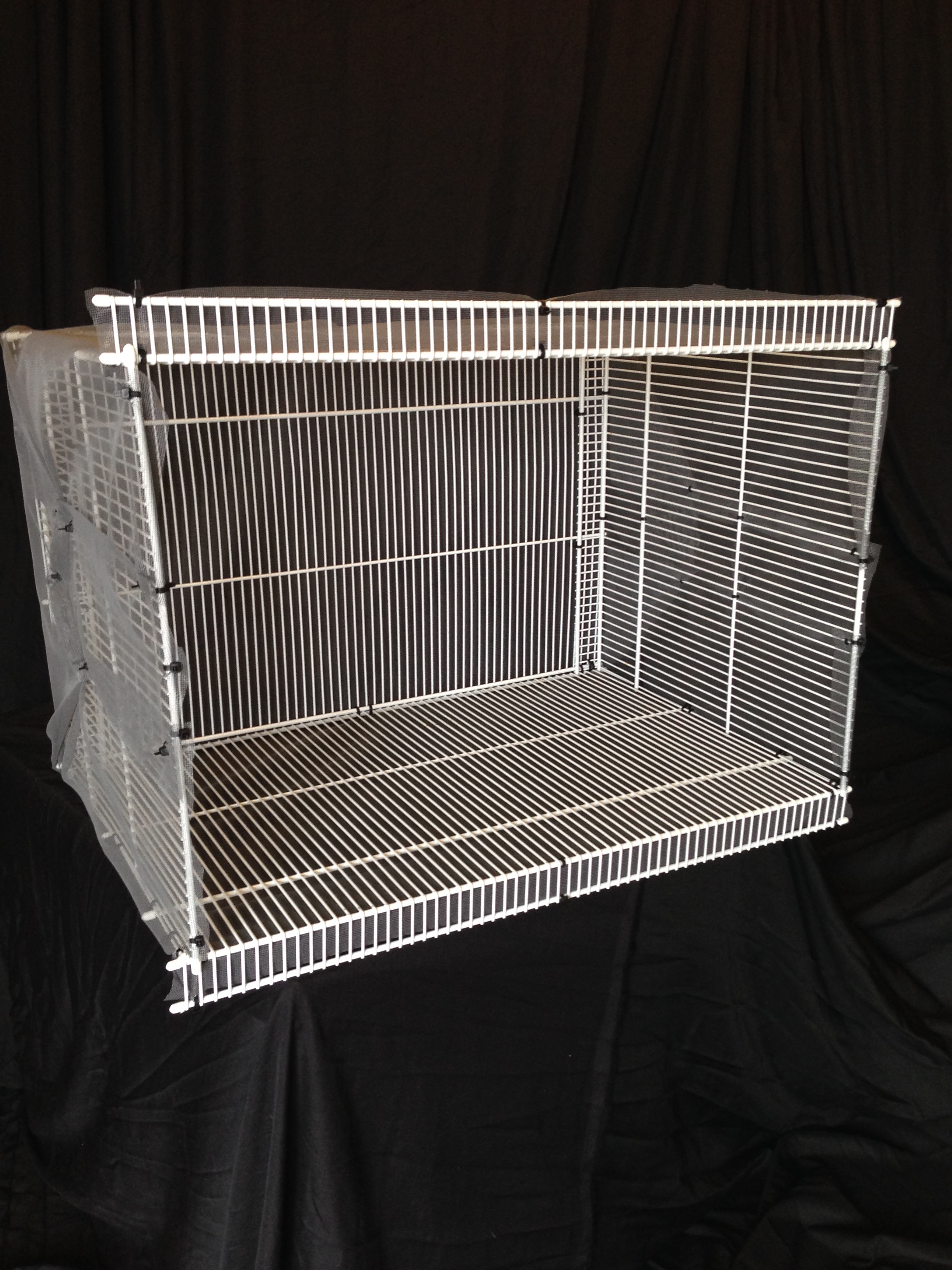 My catio is designed like a window a/c unit. The top and bottom lips hold the catio onto the window.